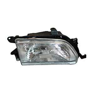 20 3299 00 Toyota Tercel Passenger Side Headlight Assembly Automotive